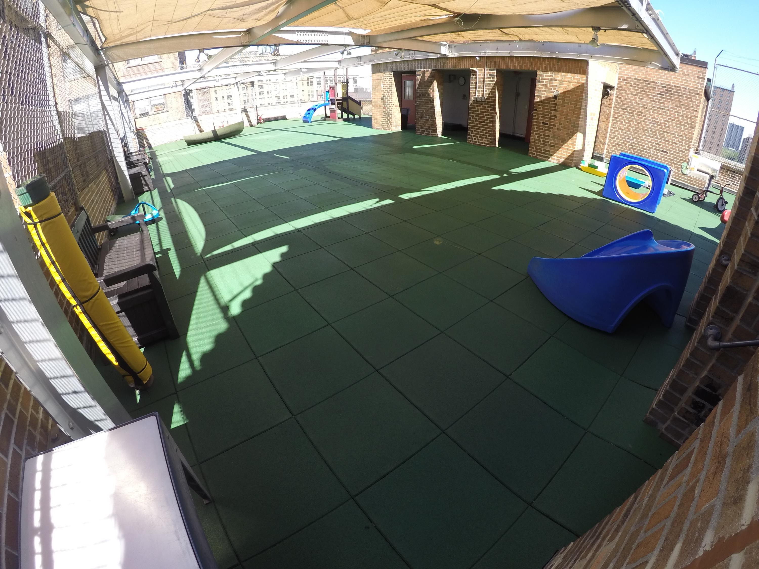 Rooftop Playground in need of a permeable rubber play tile