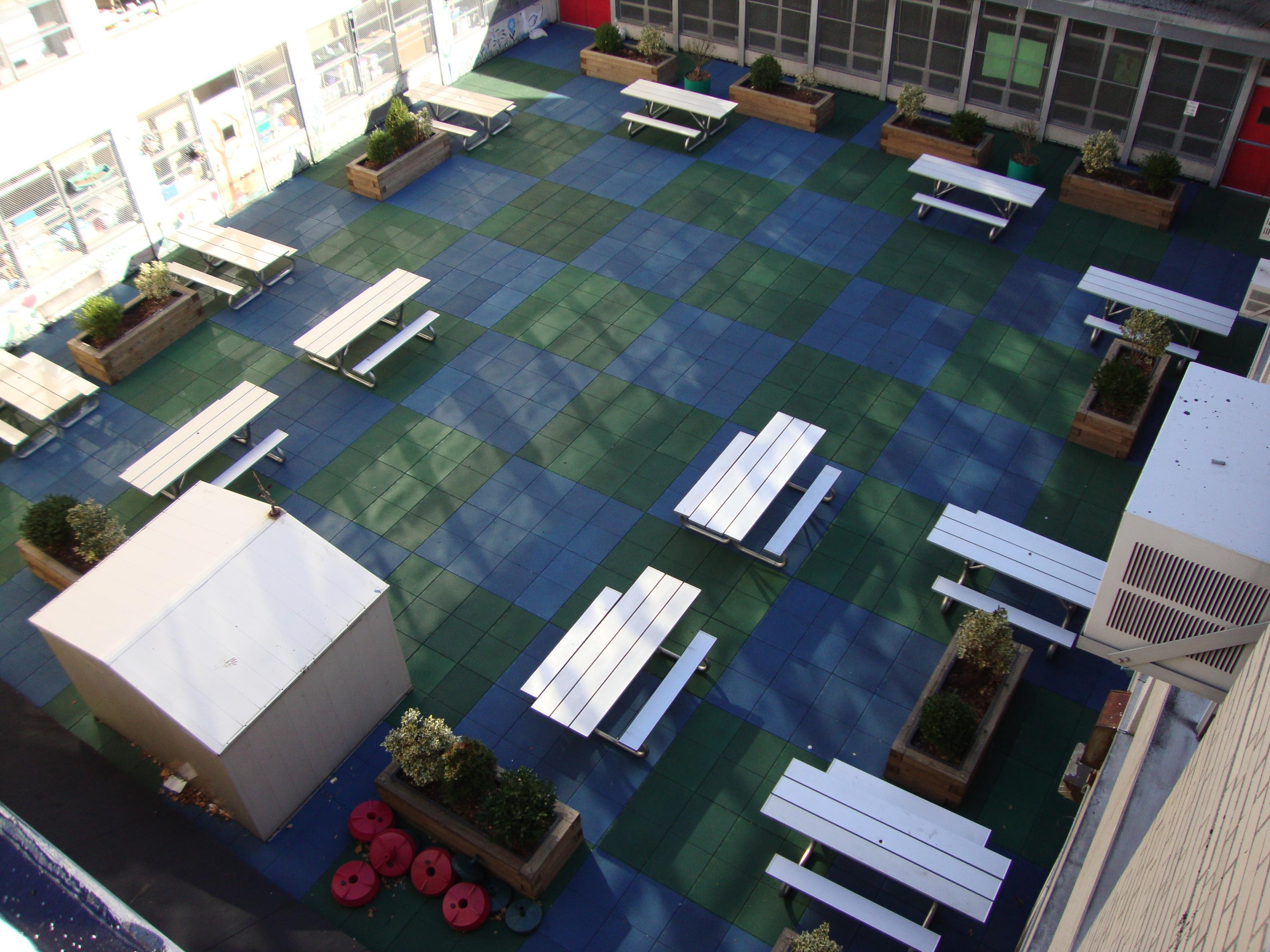 Public School Recreational Rooftop Playground Area Over Concrete Pavers