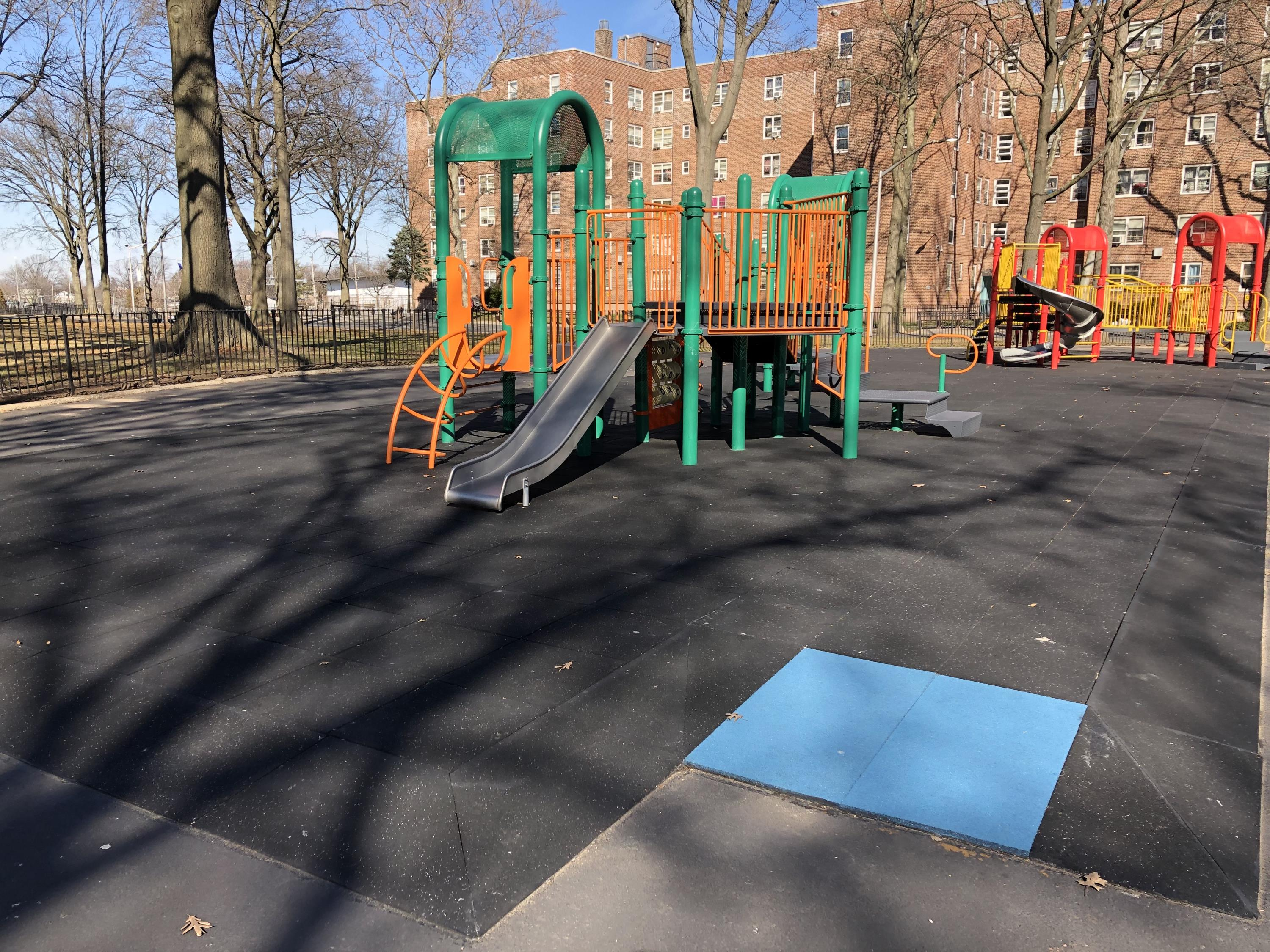 UNITY Safety Surfacing Showing Blue ADA Accessible Transitional Ramp for Playgrounds