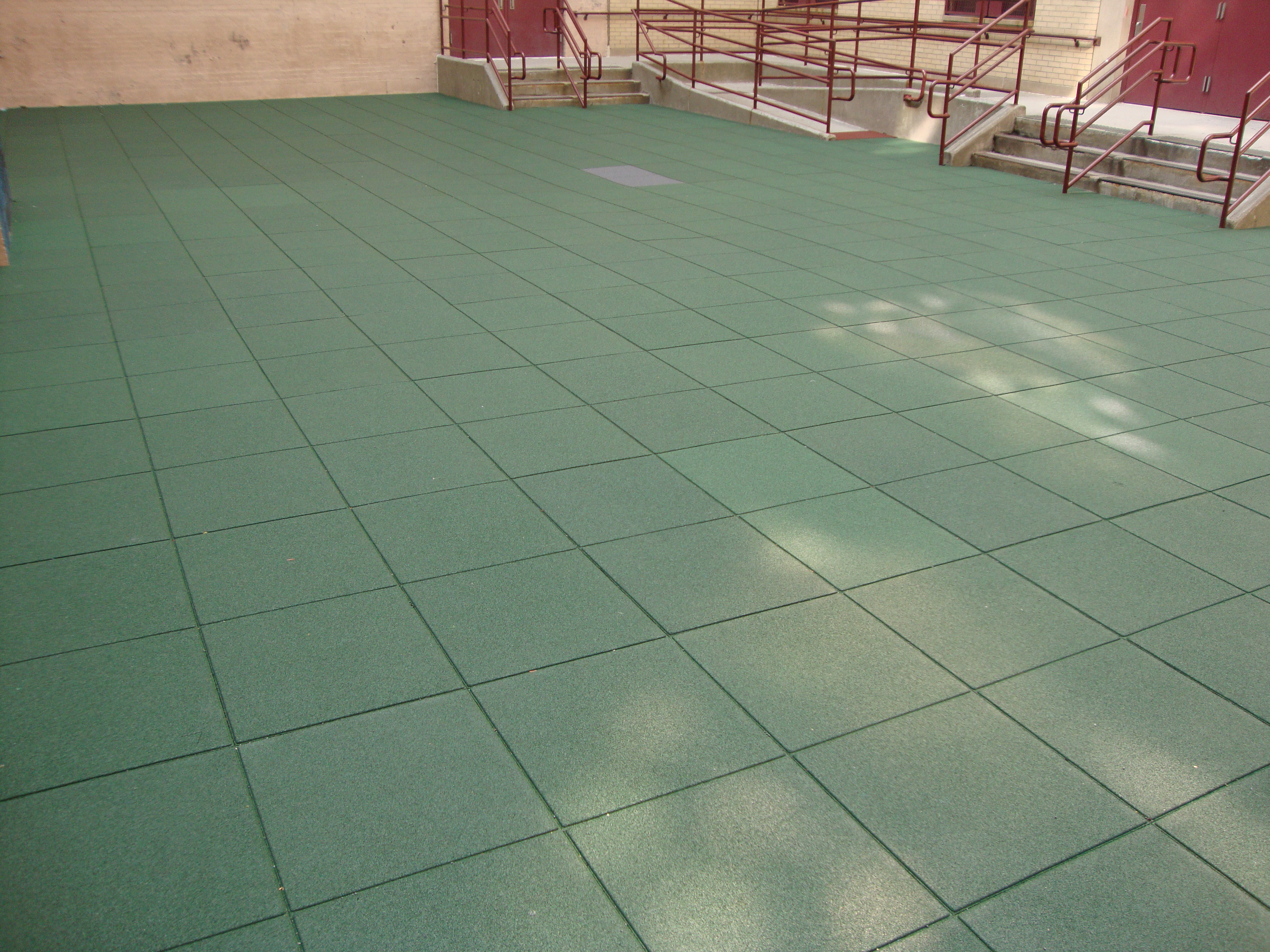 Unity daycare centers safety surfacing daycare flooring or the red tile in the very distanceat is the ada ramp the owners were so impressed with our interlocking system with button lock technology dailygadgetfo Images