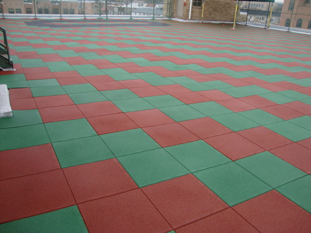 Pigmented Green and Red rubber pavers on the rooftop of this Assisted Living Facility