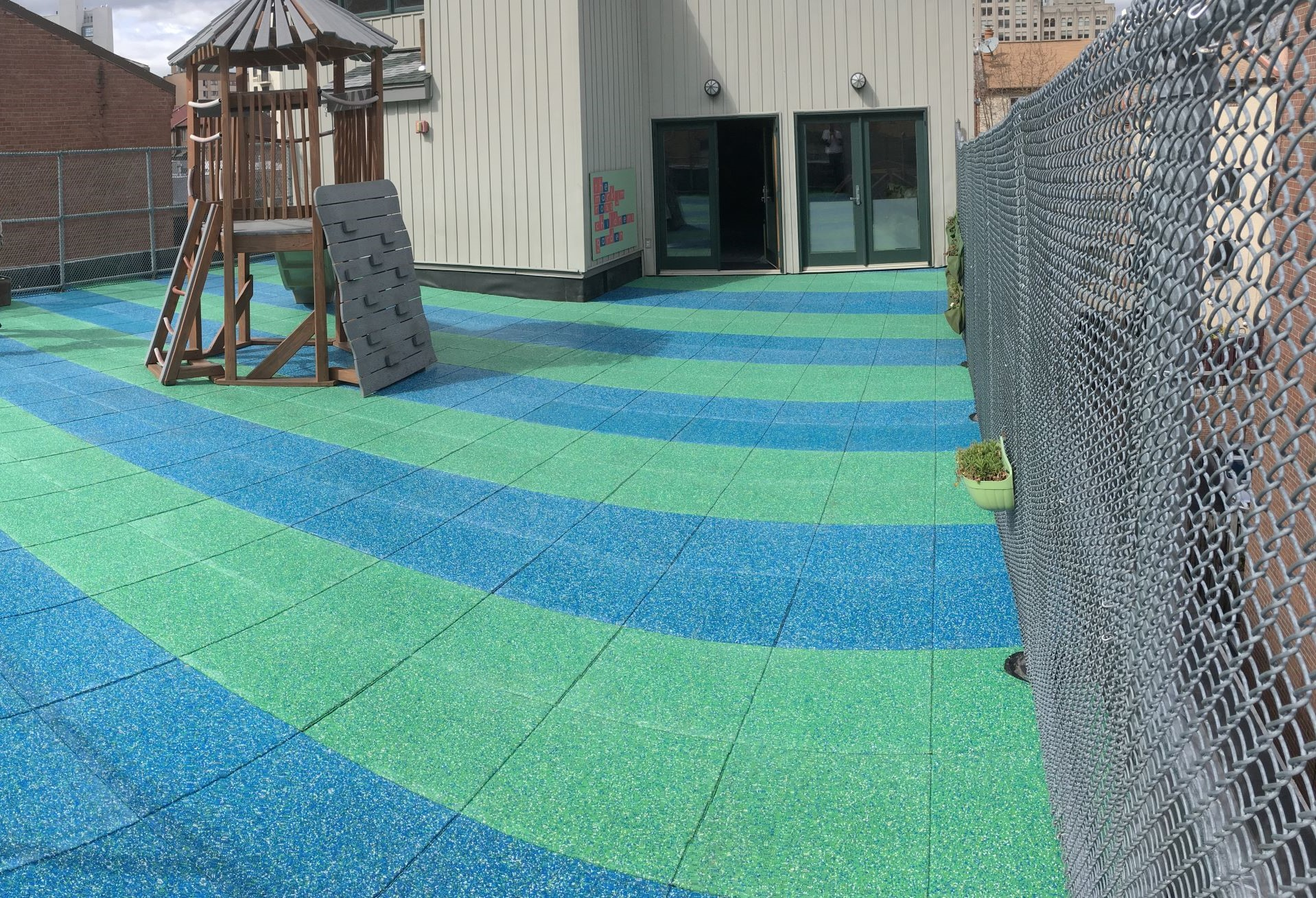 UNITY'S Rooftop Playground Pavers Using Solid TPV Top Color Chips