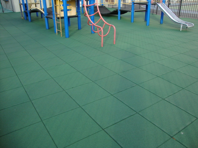 Crumb rubber tile on school playground after PIP failed