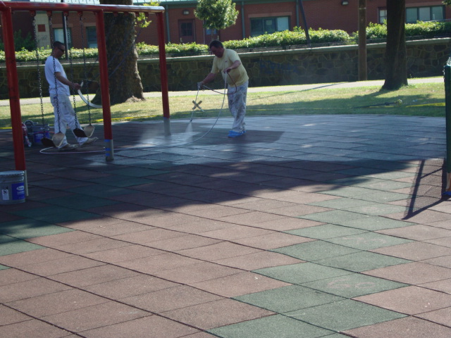 UNITY SURFACING = Showing the painting process of our playground surfacing