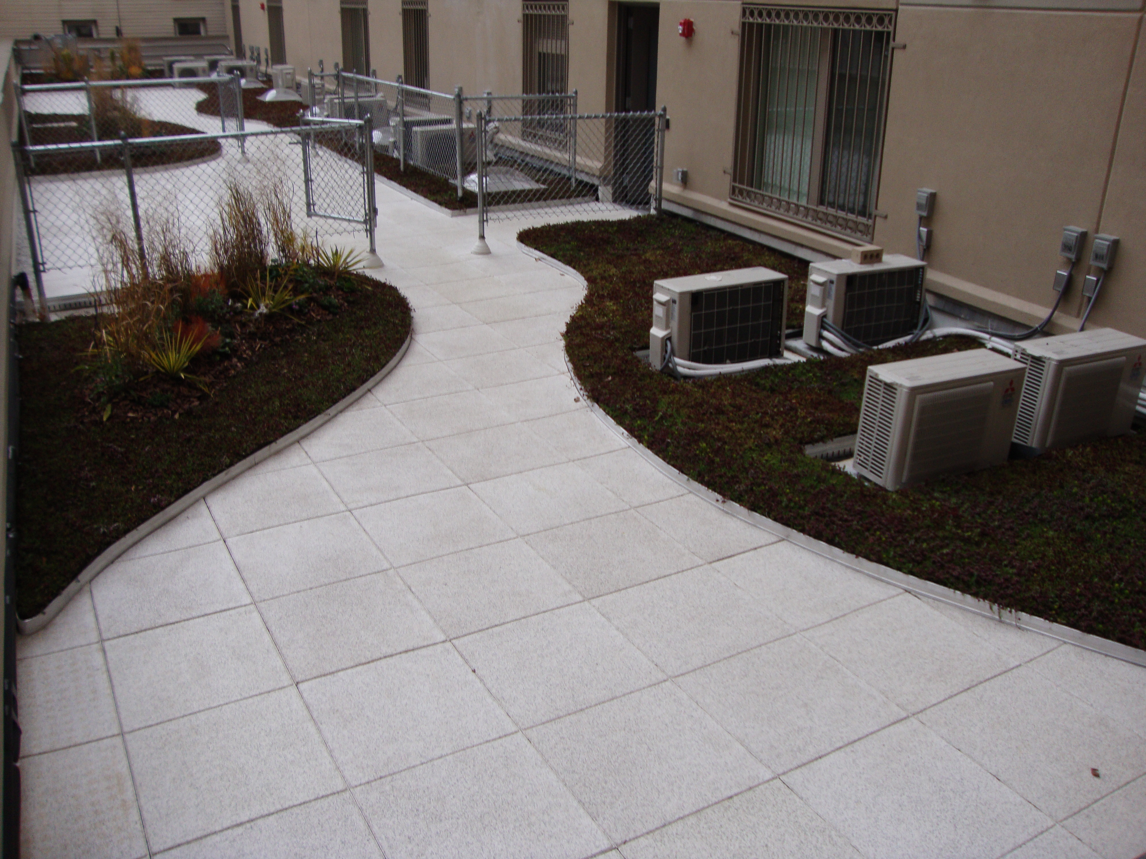 Soft Rubber Pavers Installed On This Greenroof Patio Area