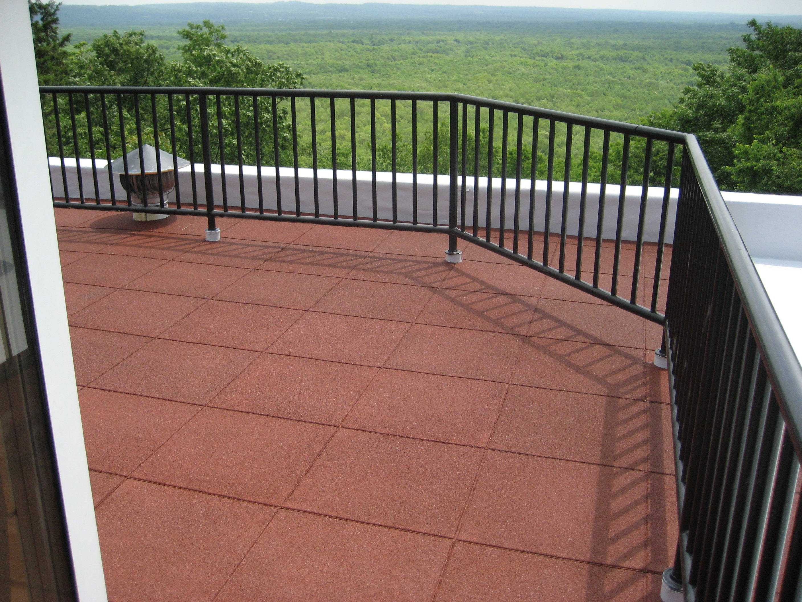 Rooftop Patio using in a rural setting using Pigmented Terra Cotta RED